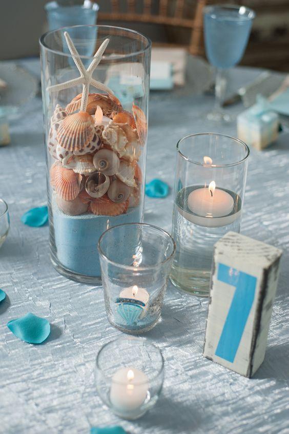 Adorable beach wedding centerpieces & table numbers / http://www.himisspuff.com/starfish-beach-wedding-ideas/10/