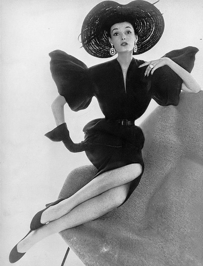 1950 Elise Daniels in tight black Moygashel linen dress with wide taffeta sleeves by Christian Dior-New York.