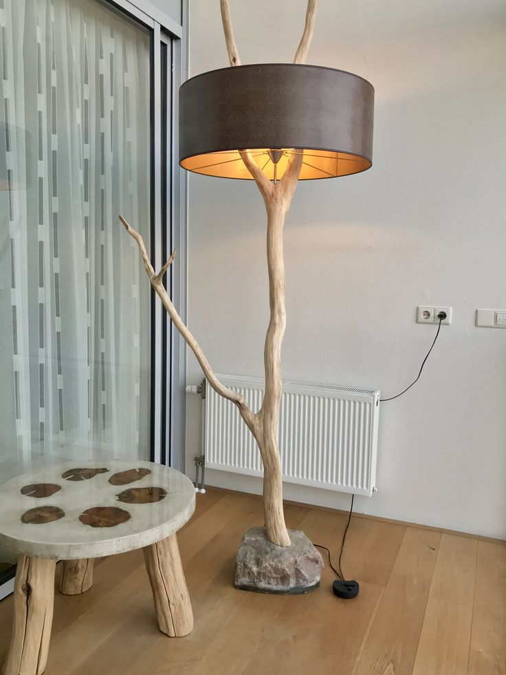 Floor lamp of old and weathered oak branch. Lampshade with leather and gold.