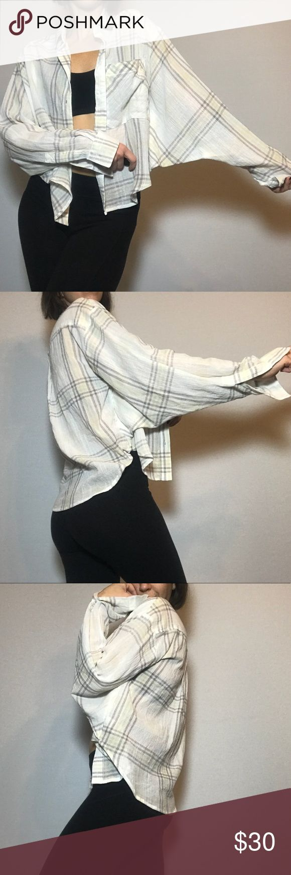 White FP plaid batwing cropped button up shirt Really unique design! Flattering cropped cut, gauzy texture. I also have this in a pastel orange. Like new condition.   No trades, other apps, or holds! 🚫 Make offers thru button not comments. 👍🏼 Usually shipped the same or next day. 📬 Clean, smoke free, cat friendly home. 🐈 Feel free to ask questions! 📩 Free People Tops Button Down Shirts