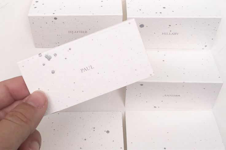 Fine art paper, sliver ink and elegant names in a traditional place setting.