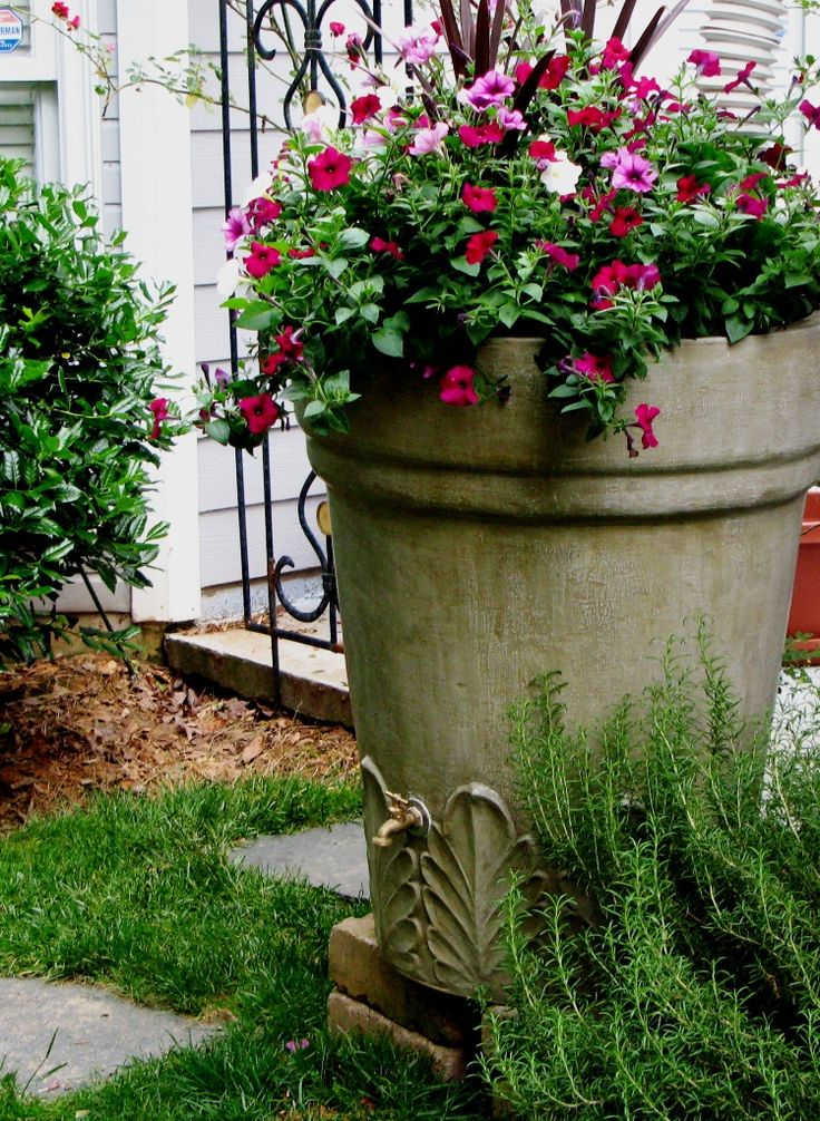 Brookhaven Rainbarrels, Atlanta, GA :: made to look like old pottery and decorative urns.