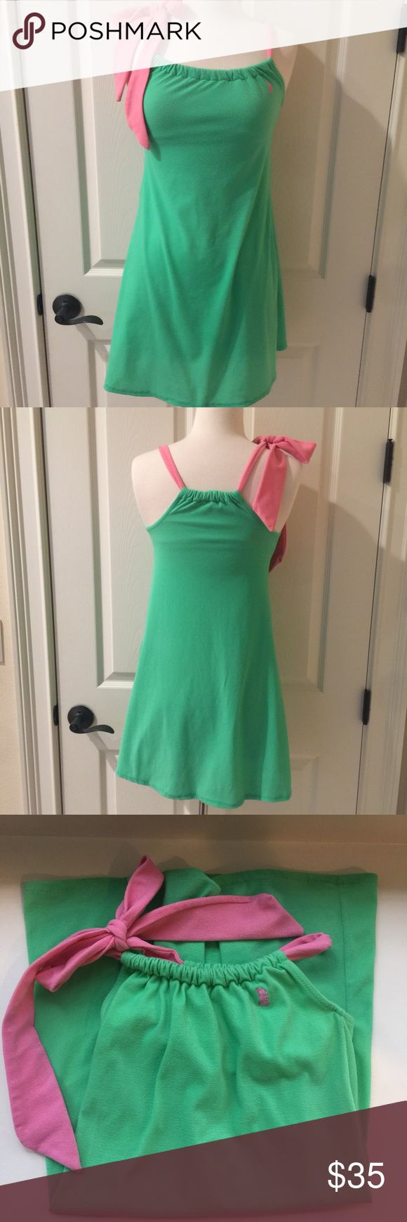 Juicy Couture swimsuit cover up size medium Juicy Couture swimsuit coverup size medium in mint green and pink. Built in bra and in excellent condition. Juicy Couture Swim Coverups