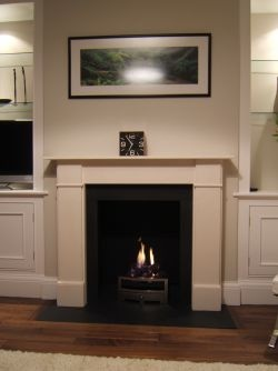 Flat victorian limestone surround. Made from Portuguese limestone moleanos. With a Honed zimbabwe granite hearth, suitable for open fires log burners and gas and electric fires.