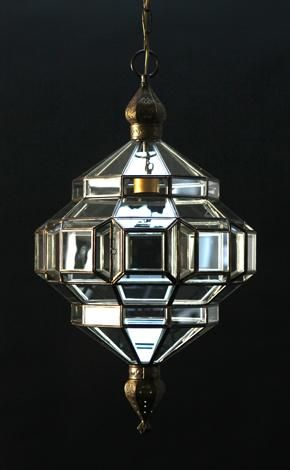 granada lantern - L'Aviva Home  these glass lanterns are made in a generations-old workshop in granada, spain. each piece is hand forged, and reflects the influence of moorish design that can be observed throughout the region.