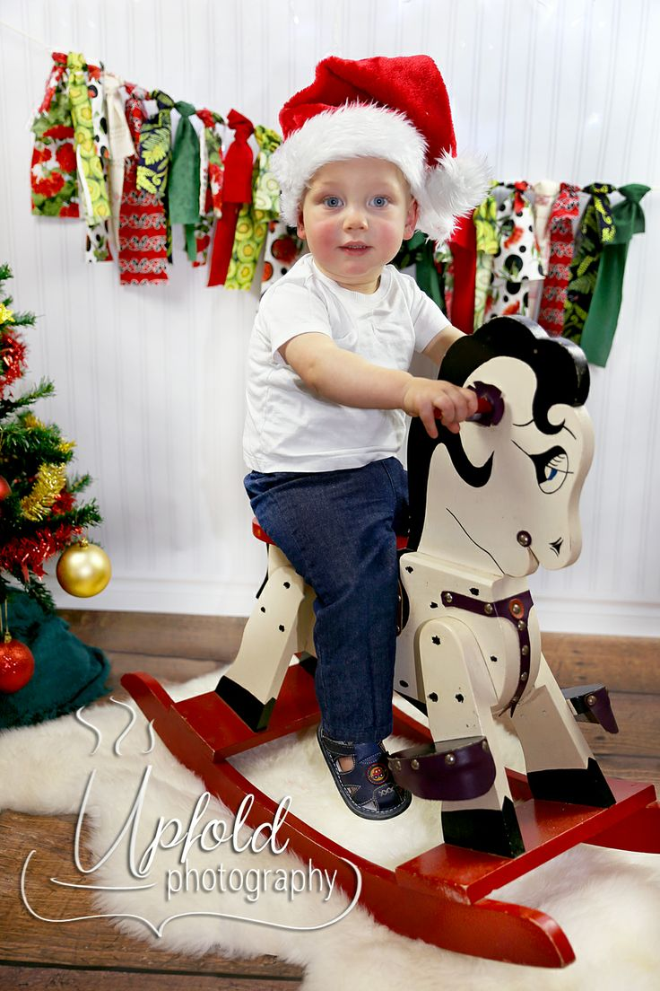 A fun Christmas photo, with this gorgeous little boy riding on a vintage rocking horse. Image by Upfold Photography, Auckland.