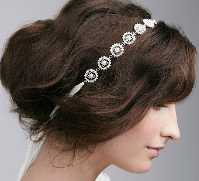 Another elegant & simple wedding hair piece.
