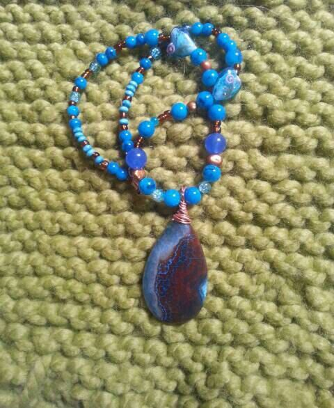 Check out this item in my Etsy shop https://www.etsy.com/uk/listing/274984978/gorgeous-agate-pendant-beaded-necklace