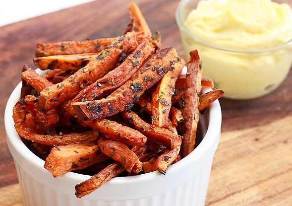 Baked Carrot and Sweet Potato Fries   1 sweet potato, washed and cut into 1/2 inch wide strips  6-8 carrots, washed and cut into 1/2 inch wide strips  2 tablespoons olive oil  2 tablespoons dried herbs (try parsley, rosemary, or thyme)  1 teaspoon salt  1/2 teaspoon pepper