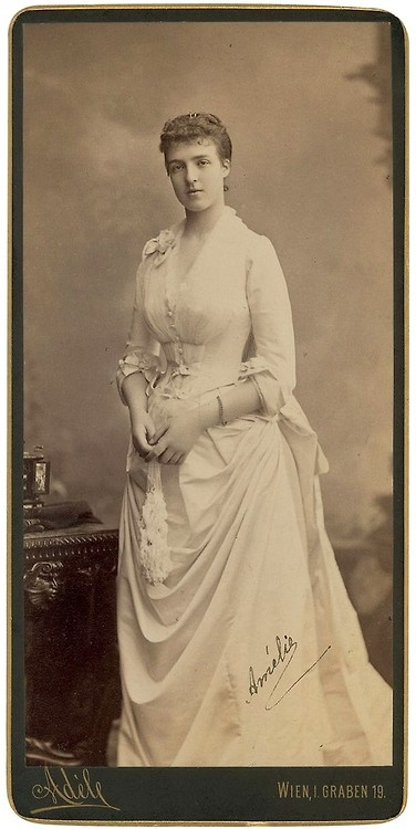 Amélie (Marie Amélie Louise Hélène d'Orléans) (1865-1951) France wife of King Carlos I (Carlos Fernando Luís de Assis José Simão) (1863-1908) Portugal. She was 1st Child of Prince Philippe d'Orléans (1838-1894) France & Marie Isabelle de Orléans y Borbón (1848-1919) Spain. In 1908 Marie Amélie's husband & son were assassinated while in a carriage with her. Carlos I was the 1st Portuguese King to die a violent death since Sebastian of Portugal in 1578.