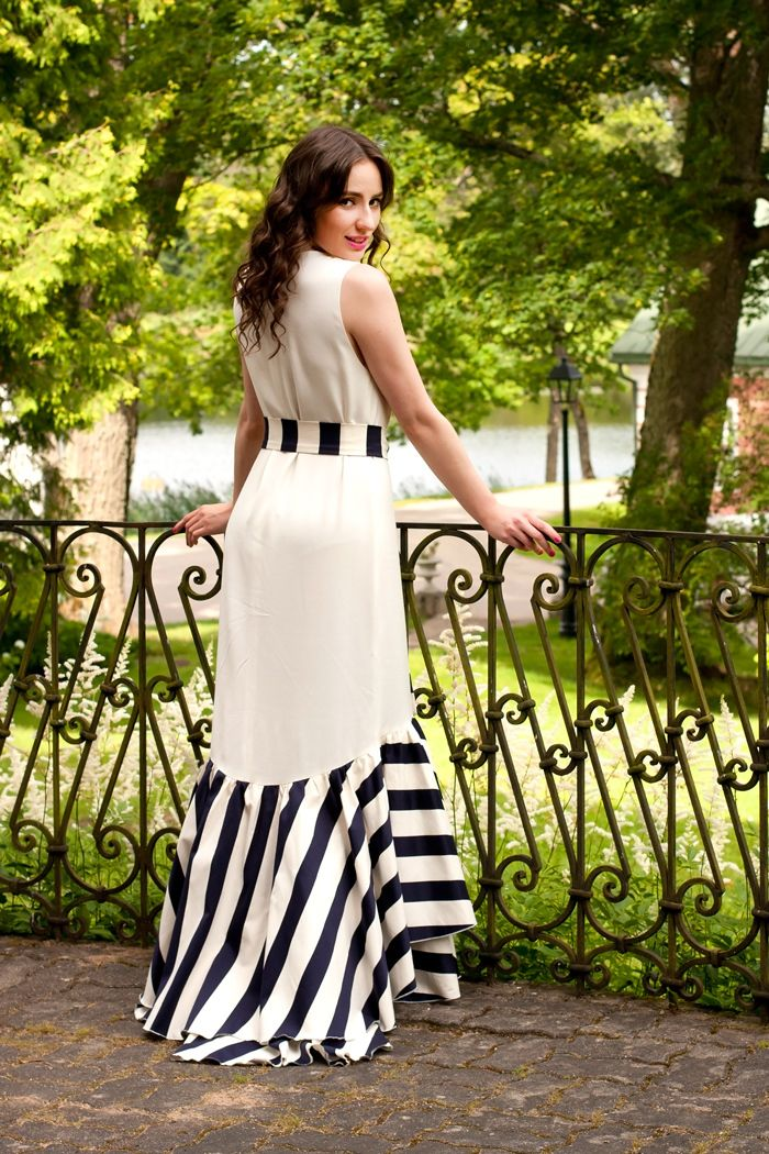 Opt for a monochrome striped evening dress to look truly gorgeous.   Shop this look on Lookastic: https://lookastic.com/women/looks/white-and-black-vertical-striped-evening-dress/13102   — White and Black Vertical Striped Evening Dress