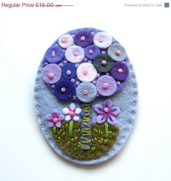 Tree felt brooch with freeform embroidery.