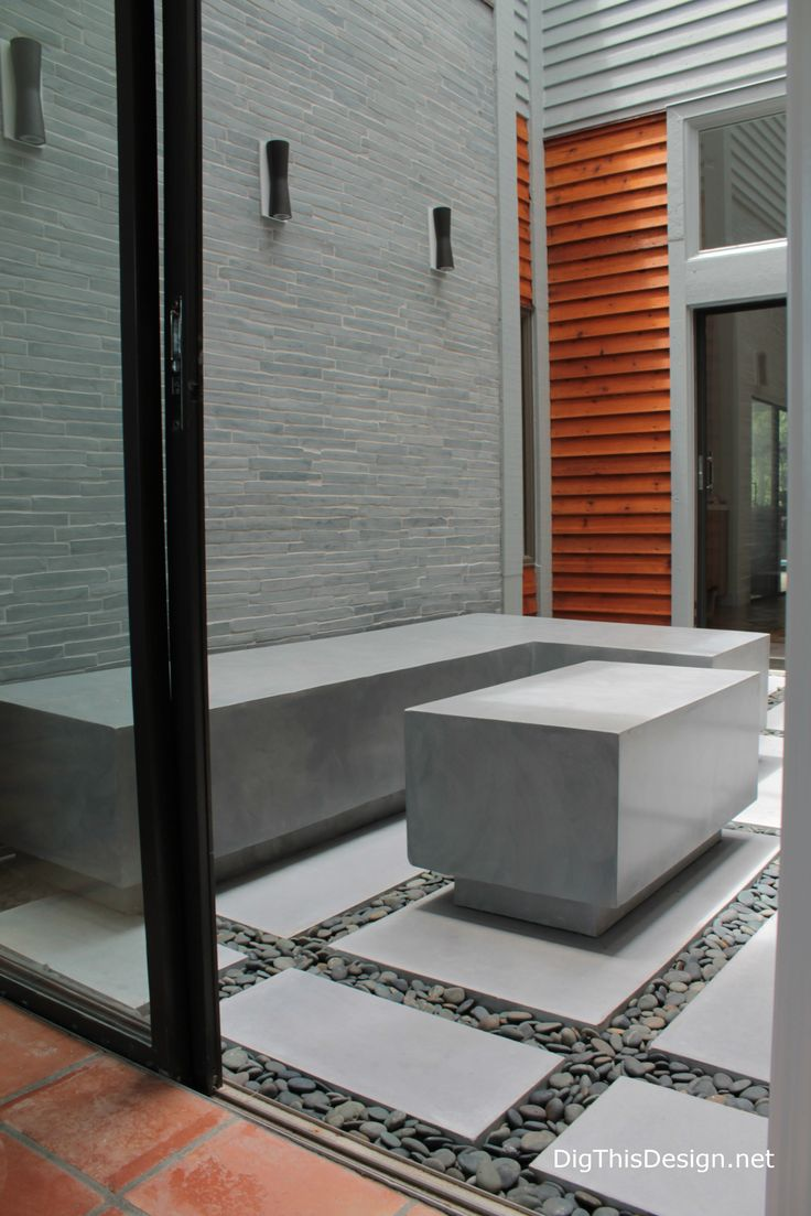 """Design by Patricia Davis Brown. """"Modern Industrial Zen"""" atrium style with Flos sconce lights, Island Stone cladding and custom concrete furniture and pavers by Coulter Designs. Enter #LoveItMoment for $1,000.00 Shopping Spree on Build.com; Tips For Outdoor Spaces and more on this interior designer's industrial zen style atrium project"""