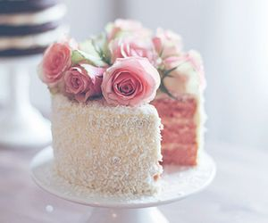 Simple white cake topped with roses