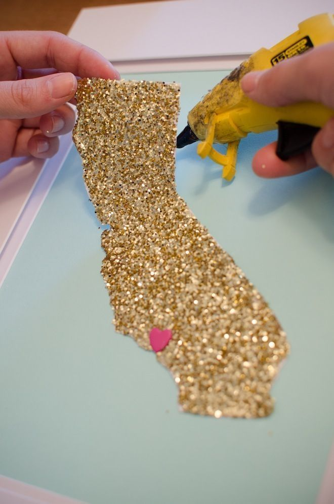 Cut your home state out on glitter paper and glue to canvas. I love this idea!