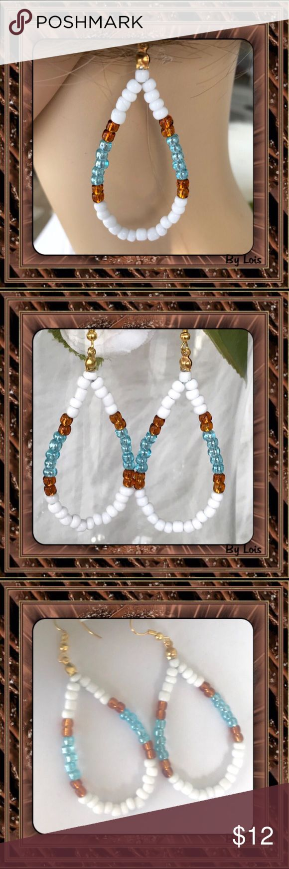 HANDMADE NATIVE AMERICAN EARRINGS Handcrafted: This pair of hoop earrings were made with large seed beads. The white are a solid and the copper and turquoise have a pearl like luster. The two colors really highlight the white which stands out visually giving it a crisp look. Light to wear and very noticeable. Fashion Flair Jewelry Earrings