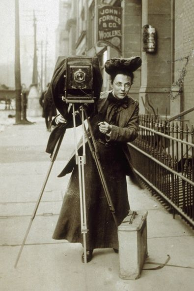 Female photojournalist Jessie Tarbox on the street with her camera, 1900s.