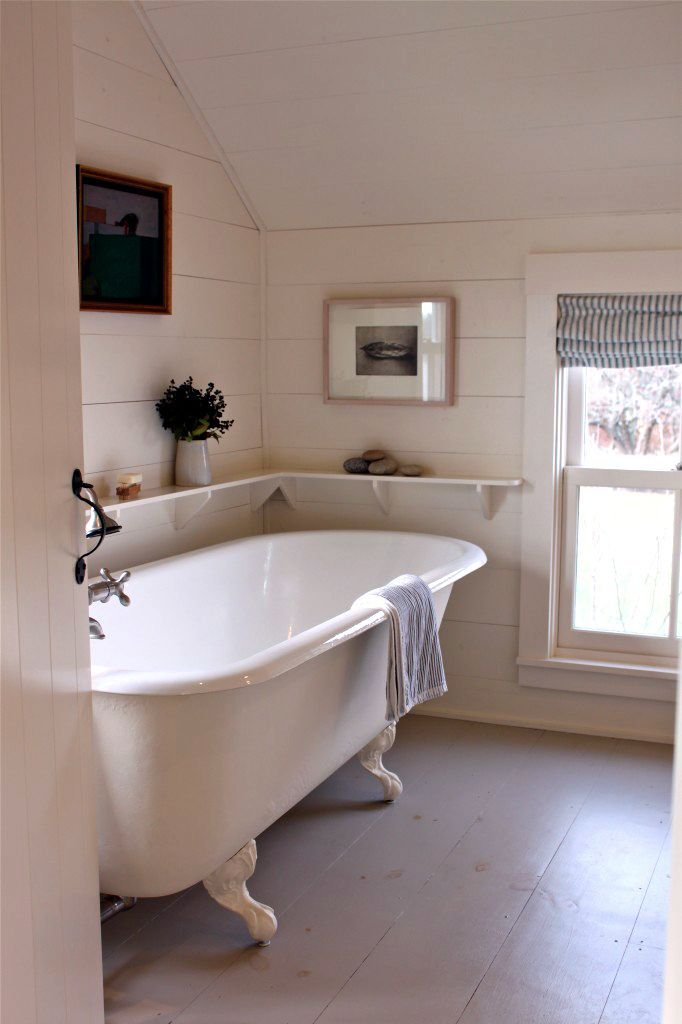 nice little shelf - timber panelling and roll top bath