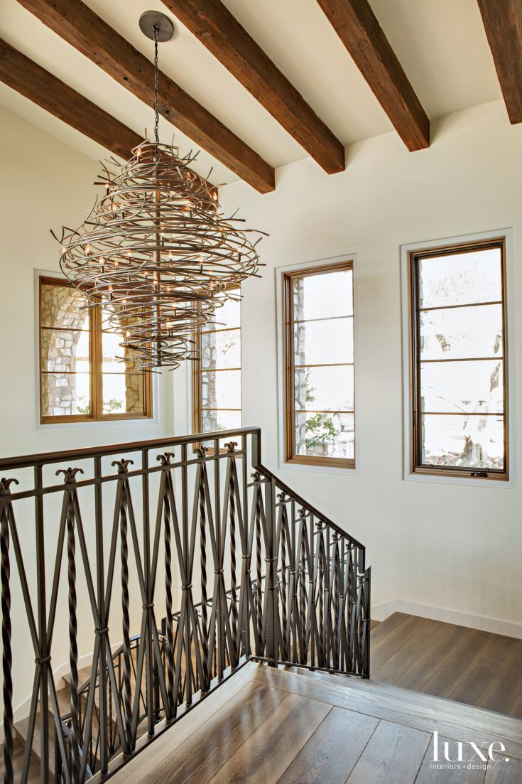 140 best styling lighting images on pinterest light fixtures a sculptural 2nd ave lighting fixture hangs from the stairwells ceiling where beams reference the arubaitofo Gallery