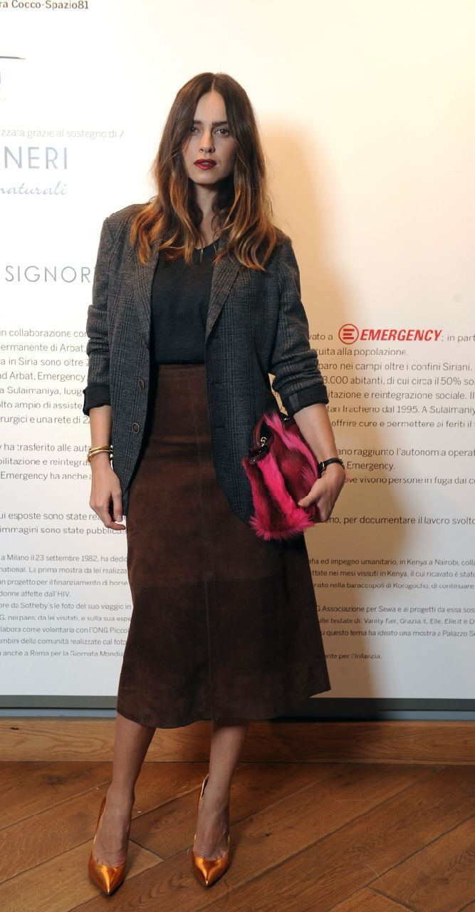 Kasia Smutniak poses with an eye-popping Fendi Fall/Winter 2014-15 Mini Peekaboo at Sotheby's in Milan