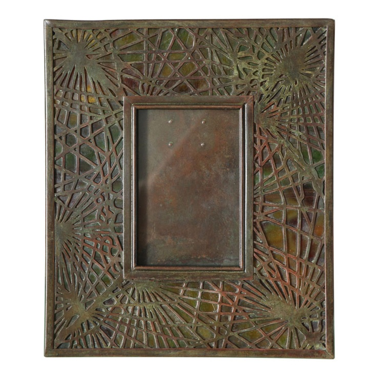 """Tiffany Studios Pine Needle Picture Frame  American  circa 1900  An American Art Nouveau patinated bronze and stained glass """"Pine Needle"""" pattern picture frame by, Tiffany Studios decorated with """"Pine Needle"""" filagree with beautifully mottled green - orange dichroic glass."""