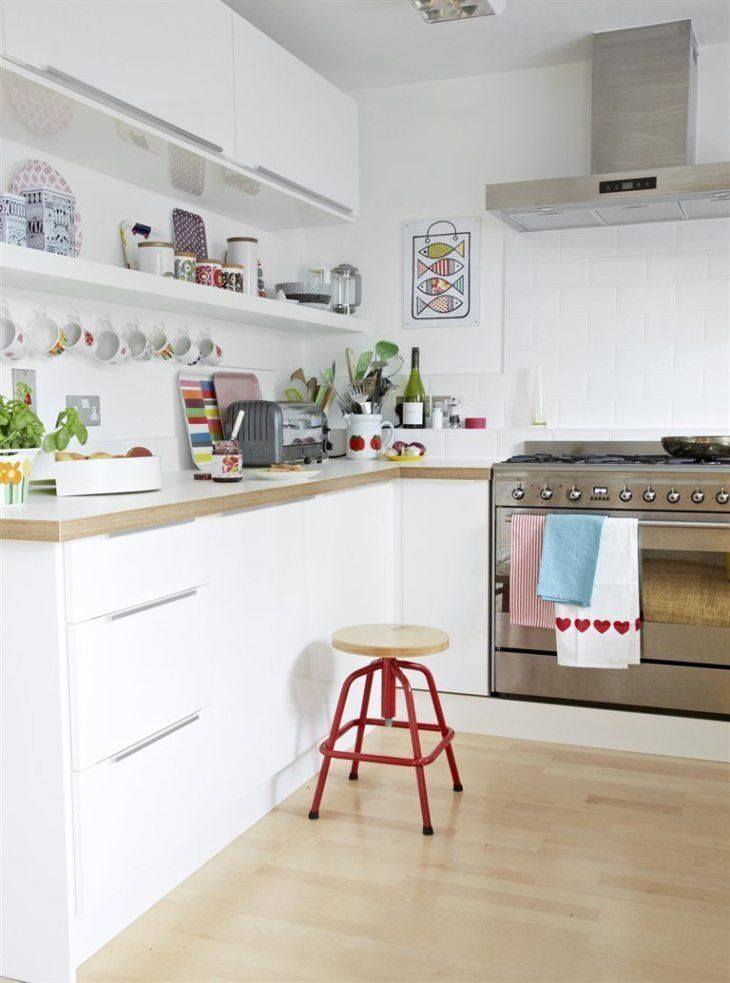 A row of upper cabinets with a single shelf below. It's the best of both worlds. The owners of this UK home, spotted on IKEA Family Live, have even hung a row of mugs below the shelf to maximize storage.