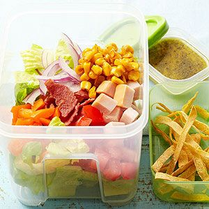 Crispy bacon and tortilla strips add crunch to every bite of this healthy turkey salad recipe./