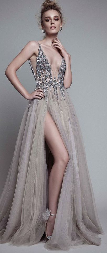 Glamorous silver embellished v-neck bodice wedding dress with thigh high slit tulle skirt; Featured Dress: Berta