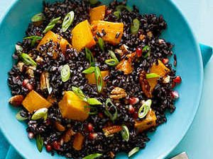 Dramatic-looking black rice--which has a mellow, sweet taste--comes from several places in the world, including Thailand and Indonesia. If you can't find it, wild, brown, or red rice would also work (cook according to package directions).