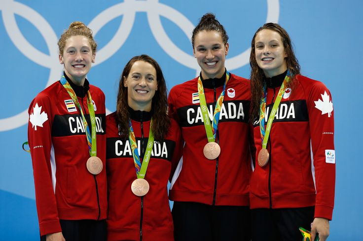 Bronze medalist Sandrine Mainville, Chantal Van Landeghem, Taylor Ruck and Penny Oleksak of Canada pose during the medal ceremony for Final of the Women's 4 x 100m Freestyle Relay on Day 1 of the Rio 2016 Olympic Games at the Olympic Aquatics Stadium on August 6, 2016 in Rio de Janeiro, Brazil.