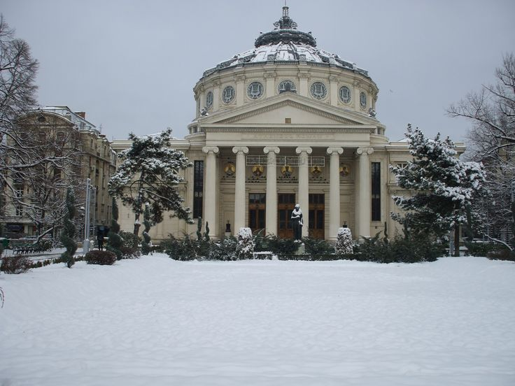 "The Atheneum is a landmark of Bucharest; was opened in 1888 and nowadays it is a host for concerts and other cultural events. In the park in front of the Atheneum stands as a ""guardian angel&…"