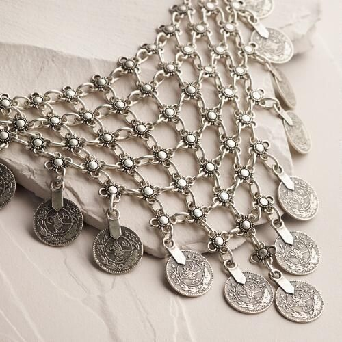 Handcrafted by one of our favorite local artisans in Istanbul, this grand piece looks like it was found in an open-air Turkish market. With layers of intricately etched coins and an antique silver finish, our necklace possesses a global spirit.