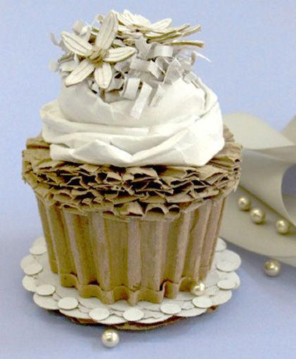 cardboard cupcake When you order from The Cardboard Kitchen, all your food is calorie-free, recycled, and earth friendly! Everything is made with love by Patianne Stevenson ! http://www.recyclart.org/2009/06/cardboard-cakes/      outside the box LU