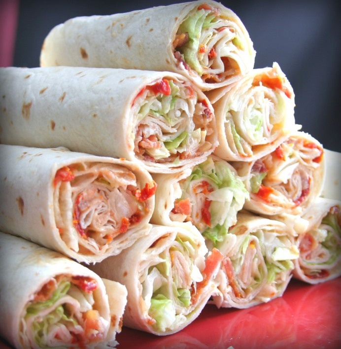 BLT Wraps--- 1 cup light mayonnaise--- ½ cup dried tomatoes in oil, drained well & chopped-- Eight (10-inch) flour tortillas--- 1 large head iceberg lettuce, chopped (I only used about half)--- 16 bacon slices, cooked & crumbled--- salt and pepper, to taste--- Combine mayonnaise & tomatoes in a small bowl. Spread evenly over 1 side of each tortilla, leaving a ½ inch border. Sprinkle lettuce & bacon evenly over tortillas; sprinkle with salt & pepper. Roll up tortillas tightly; cut i...