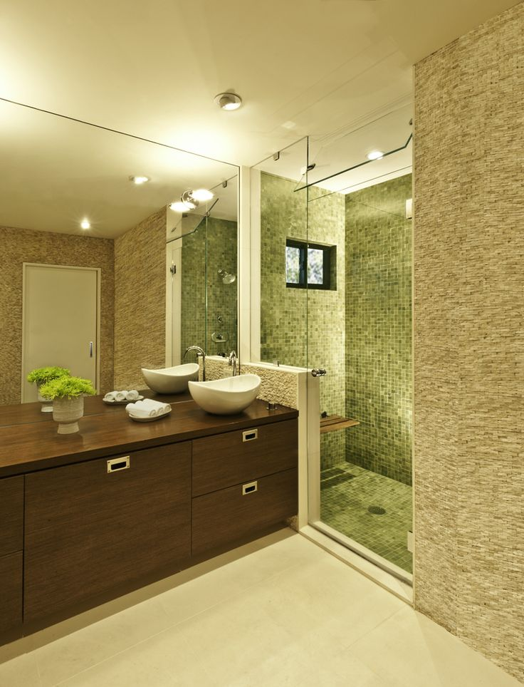 Master bath with stone tile walls (travertine) by Kim Colwell Design