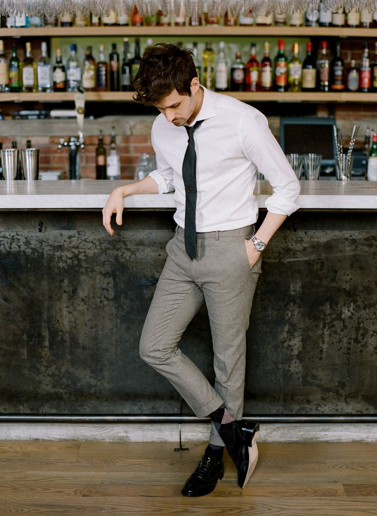 Something as simple as opting for a white dress shirt and grey wool dress pants can potentially set you apart from the crowd. Opt for a pair of black leather brogues for a more relaxed feel.   Shop this look on Lookastic: https://lookastic.com/men/looks/dress-shirt-dress-pants-brogues/14277   — White Dress Shirt  — Black Tie  — Silver Watch  — Grey Wool Dress Pants  — Black Leather Brogues  — Black Argyle Socks