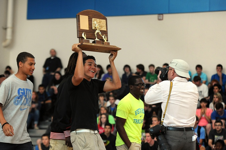 Twelfth grader Brandon Cartagena, 17, holds the boys' track and field 4A State Championship trophy during a pep assembly May 21 at Vista Ridge High School in Falcon School District 49. Competing in the athletic program's fifth year, the track and field team earned the school's first state title May 18. The Wolves set a 4A meet record in the 1,600-meter relay. Everyone who competed scored points in outstanding team effort.