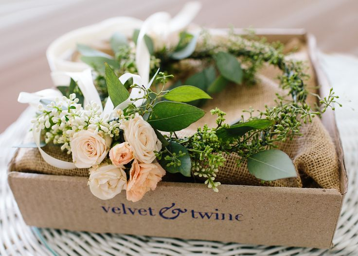 flower crown arrives for wedding day of peach spray roses, ligustrum blooms and seeded eucalyptus.