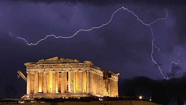 The ancient Greek Parthenon temple, atop the Acropolis hill overlooking Athens, is framed by a lightning bolt during a thunderstorm that broke out in the Greek capital, on Oct. 9, 2006. (Aris Messinis/AFP/Getty Images)