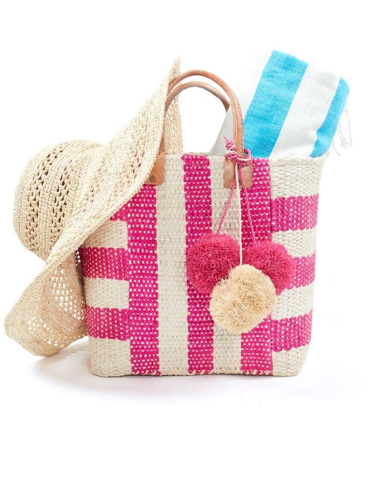 This gift bag has all the essentials you need for a day at the beach! A Beach Bag, Hat, and Towel.