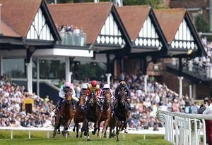 Kingston Kurrajong ridden by David Probert leads the field with eventual winner Platitude on his shoulder in the Betdaq Dee Stakes at Chester Racecourse.
