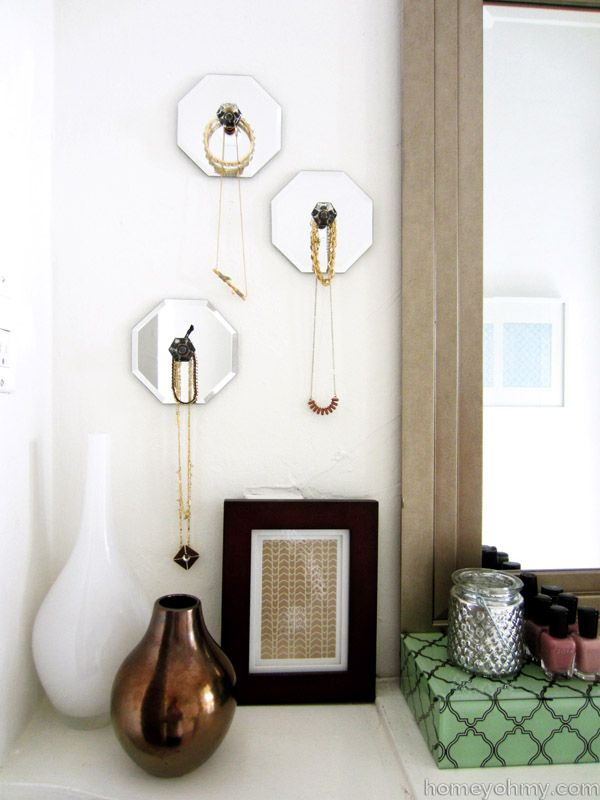 Make gorgeous jewelry hangers using acrylic knobs, craft glue, and a few cheap hexagonal mirrors (these came from the dollar store!). #DIY