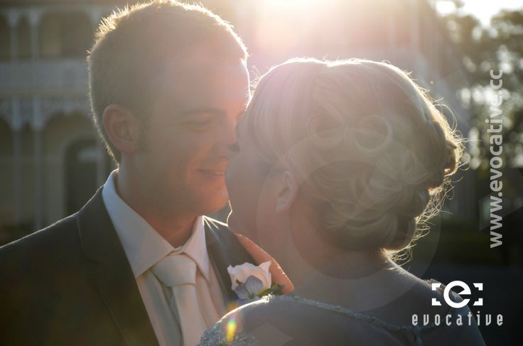 Bride and groom touching noses in the afternoon sunlight, at Woodlands of Marburg. #WeddingPhotography #LensFlare