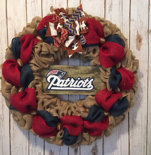 24 burlap New England Patriots wreath. Made with natural color burlap on a wire wreath frame. Decorated with red and blue burlap ribbon, mini footballs, a wood hand painted Patriots sign, and a big bow with chevron stripe & football lace ribbon. This is the perfect New England Patriots front door wreath for the Patriots fan. Makes a great Christmas gift, house warming gift, birthday gift, football wreath, etc...