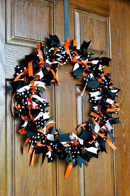 DIY Halloween Wreath - i think I could do this.... i would just cut a pool noodle to the right length and then duct tape it to a circle and tie ribbon to it