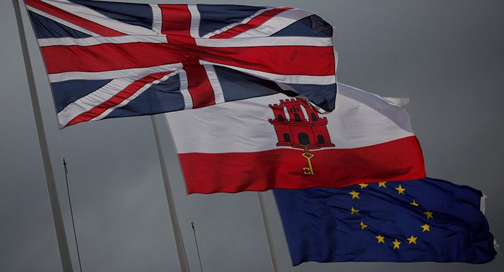 The Union Jack (L), the Gibraltarian flag (C) and the European Union flag are seen flying at the border of Gibraltar with Spain, in the British overseas territory of Gibraltar, historically claimed by Spain April 3, 2017.