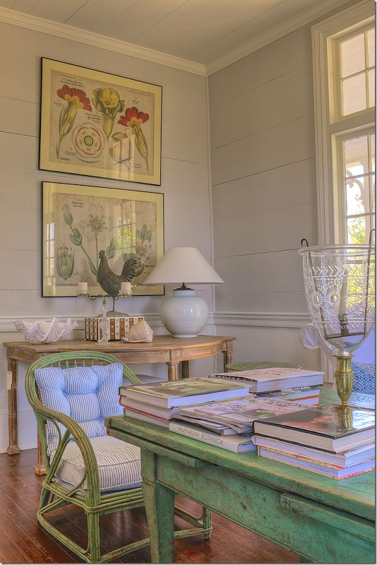 beautiful vignette, love the demilune, the green table and chair, the botanicals and painted plank walls