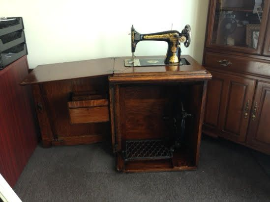 This is such a beautiful piece - antique Singer sewing machine -$250, great for collectors or a lovely addition to any home!