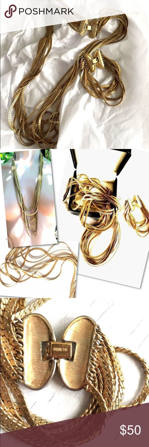 VINTAGE SIGNED MONET GOLD NECKLACE BRACELET SET VINTAGE SIGNED  MONET  GRADUATED 8 STRAND GOLD CHAIN NECKLACE   Long 8 strands in different lengths. It is in very good vintage condition.                  Matching bracelet is beautiful  Probably from the 70's. Monet Jewelry Necklaces