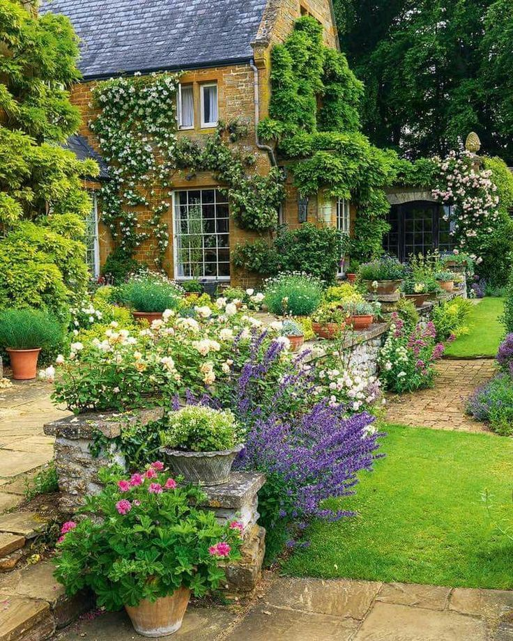 In this garden, york stone flagstones set off the planting and the house so beautifully!